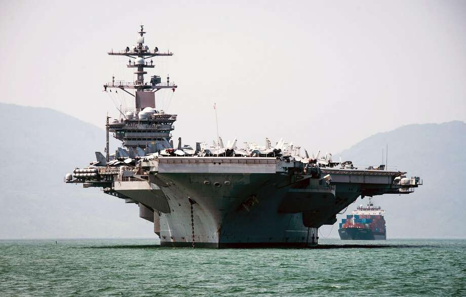 The Nimitz-class aircraft carrier Carl Vinson is anchored in Danang, Vietnam, for a port visit. The visit by the Navy comes as China increases its military buildup around the region. Photo: DEVIN M. MONROE, AFP/Getty Images