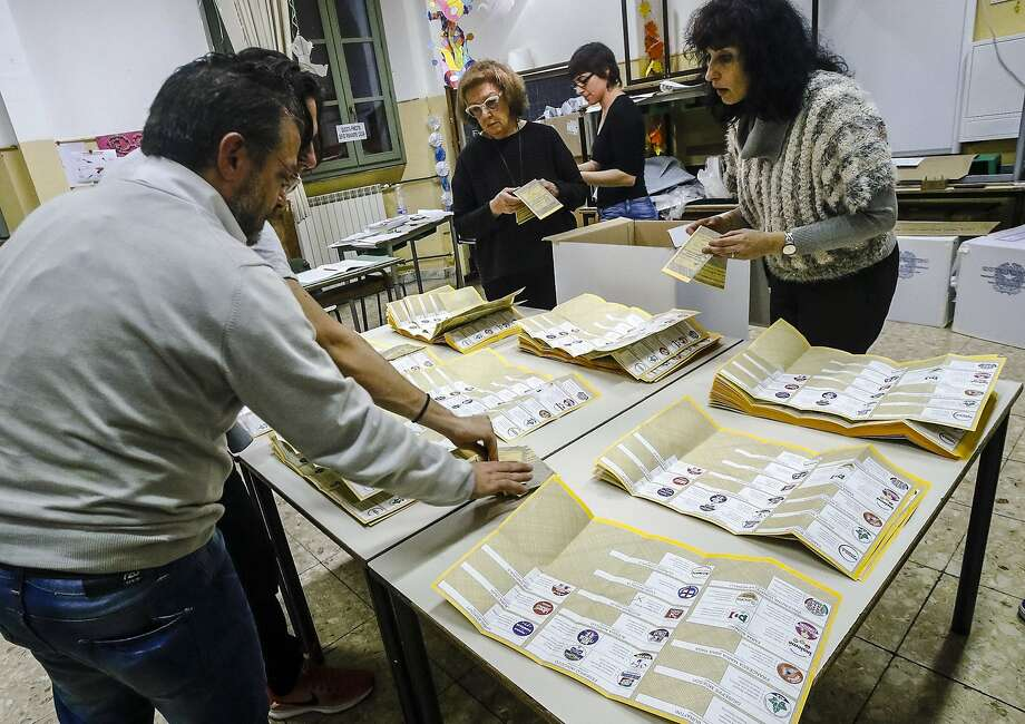 Poll workers check ballots at a voting station in Rome on Sunday. Critics of the European Union triumphed in the election, the latest indication that the continent is tilting further to the right. Photo: Giuseppe Lami, Associated Press