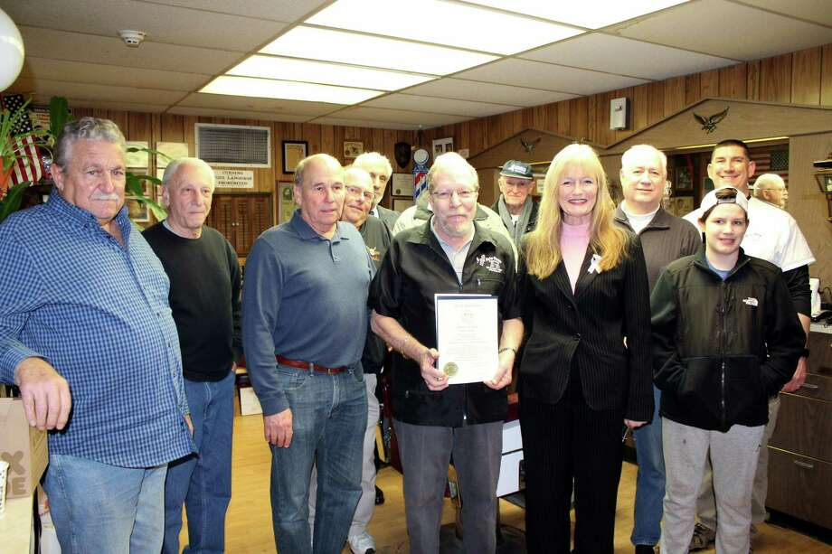 "Ye Olde Barber Shoppe celebrates 50 years: Ye Olde Barber Shoppe owner Joseph Libero receives a citation for 50 years in business from Mayor Nancy R. Rossi earlier this month at 356 Campbell Ave. Joining the celebration are friends and patrons of Libero, from left, Ray Ludoviconi, Frank Dottori, Ken Ferris, Bernie Ferris, mayoral Executive Assistant Louis P. Esposito Jr., Harold Bellmore, Don Byrne, John Patry, and Scott Gardner and his son, Kevin. Rossi recognized Libero, 72, a longtime city resident, for ""the celebration of your golden anniversary and your prolific career in the haircutting business."" Reading the citation aloud, Rossi said, ""For 50 years, Ye Olde Barber Shoppe, like so many other small businesses, has been the lifeblood of our city, exemplifying the very best of West Haven."" Photo: Contributed Photo / City Photo - Michael P. Walsh /"