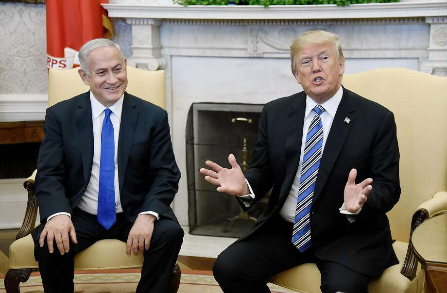 Israeli Prime Minister Benjamin Netanyahu (left) discusses Mideast security issues with President Trump in the Oval Office of the White House. Photo: Olivier Douliery, TNS