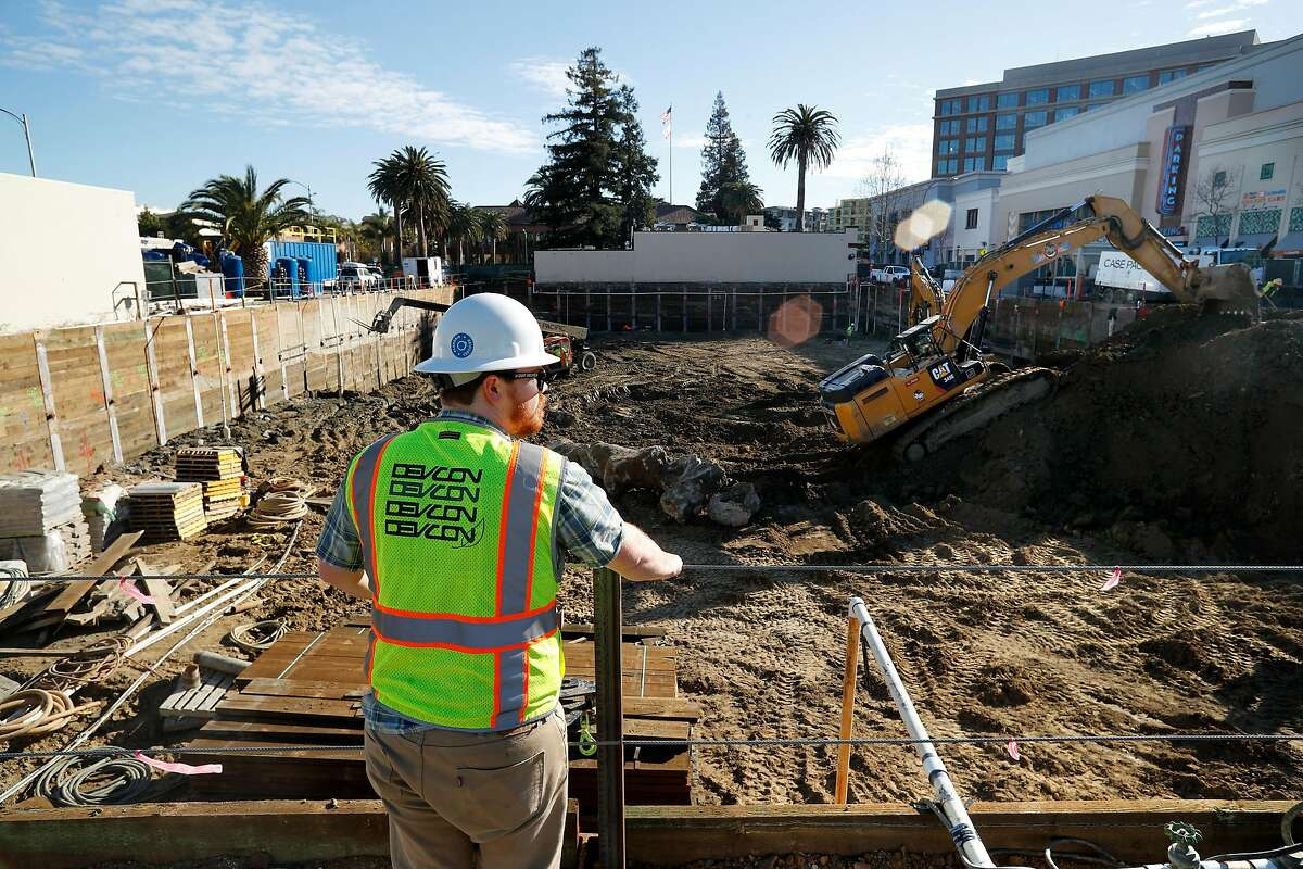 Project engineer Will Smithers looks out over the construction site in downtown Redwood City, Calif., as seen on Wednesday Feb. 14, 2018. The Chan Zuckerberg Initiative has leased 102,079 square feet in the new project in Redwood City, in one of the largest office deals signed last year in the Peninsula.