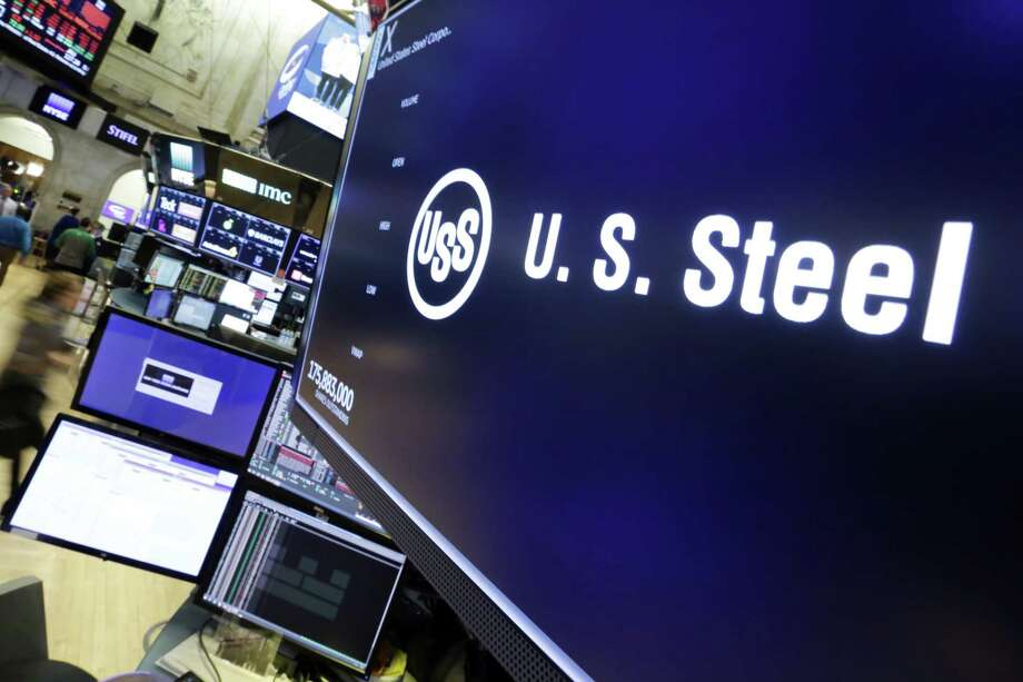 The logo for U.S. Steel appears above a trading post on the floor of the New York Stock Exchange on Friday. (AP Photo/Richard Drew) Photo: Richard Drew / AP