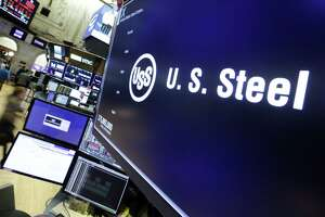 The logo for U.S. Steel appears above a trading post on the floor of the New York Stock Exchange on Friday. (AP Photo/Richard Drew)