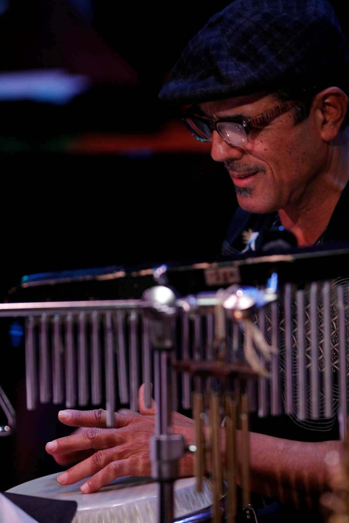Percussionist John Santos plays with Electric Squeezebox Orchestra during the Cal Jazz Conservatory Fiddler Annex grand opening week final concert in Berkeley, Calif., on Sunday, March 4, 2018. The concert featured the Electric Squeezebox Orchestra, a 17-piece big band led by Erik Jekabson and special guest percussionist John Santos as well as the Cosmic Conquerors, a 14-piece big band, led by Isaiah Hammer.