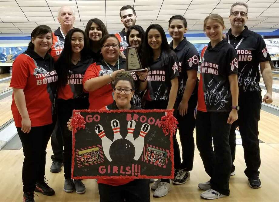 The Clear Brook girls' bowling team recently won the Region VIII championship. Team members are (back row, left to right) coach Cecil Rutherford, coach Dario Vaccaro, and coach Jason Lee (middle row) Xander Mata, Lynn Cao, Rabeeah Bhathy, coach Roxy Casas, Adrianna Gammon, Kassandra Razo, Kayla Chavez, Allison Lee (front row) Alexis Hernandez. The state tournament is March 24-25 in San Antonio. Photo: Submitted Photo