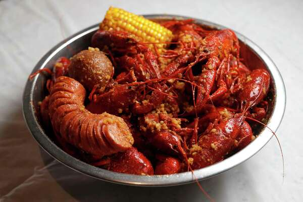 2of 9a Three Pound Order Of Y Vietnamese Cajun Crawfish At Noodles Made By Tossing Boiled In Garlic Er Es And Ground Chile