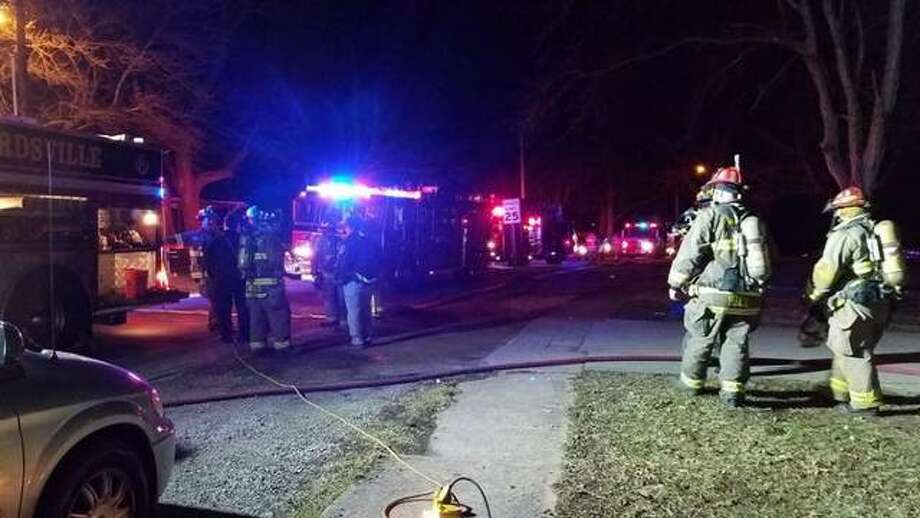 Edwardsville firefighters respond to a house fire on Hale Avenue early Sunday. Photo: For The Telegraph