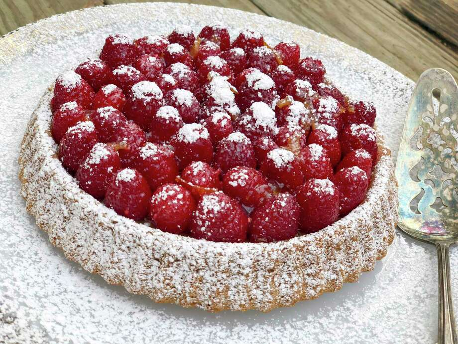 This Dec. 4, 2017 photo shows an orange and raspberry tart in Bethesda, Md. This dish is from a recipe by Melissa d'Arabian. (Melissa d'Arabian via AP) Photo: Melissa D'Arabian, UGC / Melissa d'Arabian