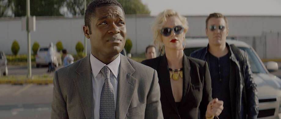"""David Oyolewo (left) is the title character in """"Gringo,"""" with Charlize Theron and Joel Edgerton as pharmaceutical executives. Photo: Amazon Studios"""