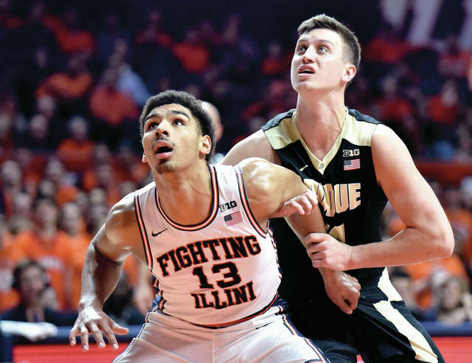 Illinois' Mark Smith (13) seals off Purdue's Grady Eifert (24) while waiting for a rebound during the first half a Big Ten Conference game Feb. 22 in Champaign. On Monday, Smith requested and received his release from Illinois and will transfer after completing the semester in Champaign. Photo: Associated Press