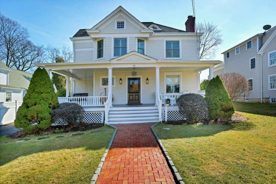 The 12-room Victorian house at 29 Church Street in New Canaan is within walking distance to the Metro North train station and the town center with its shops and restaurants.