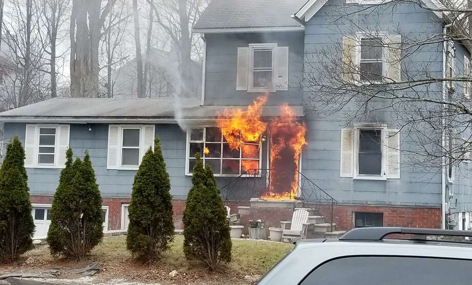 This photo, taken by neighbor Rocco Corriere III, shows flames shooting out of a home at 26 East Pembroke St. in Danbury, Monday, March 5, 208. Photo: Rocco Corriere III / Hearst Connecticut Media / The News-Times Contributed