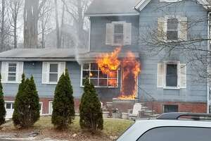 This photo, taken by neighbor Rocco Corriere III, shows flames shooting out of a home at 26 East Pembroke St. in Danbury, Monday, March 5, 208.