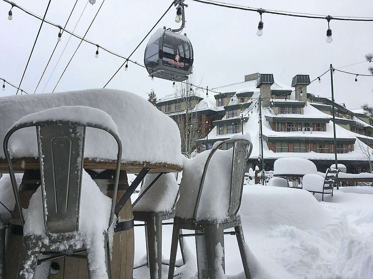 File - In this March 2, 2018, file photo provided by the Heavenly Mountain Resort, fresh snow covers most of a table and chairs in South Lake Tahoe, Calif. Welcome drifts of fresh snow awaited California's water managers on their late-winter survey of the vital Sierra Nevada snowpack Monday, March 5, 2018, after a massive winter storm slowed the state's plunge back into drought. The storm piled up to 8 feet of new snow in the mountains from late last week through the weekend, forcing Department of Water Resources officials to postpone the measurement for a few days. (Heavenly Mountain Resort via AP, File)