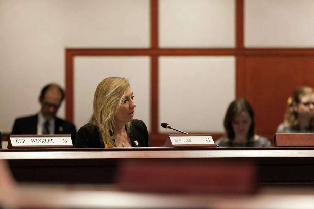 A public hearing was conducted last week on a bill that would create a registry for sober homes in Connecticut. Above, state Rep. Michelle Cook speaks during the hearing.