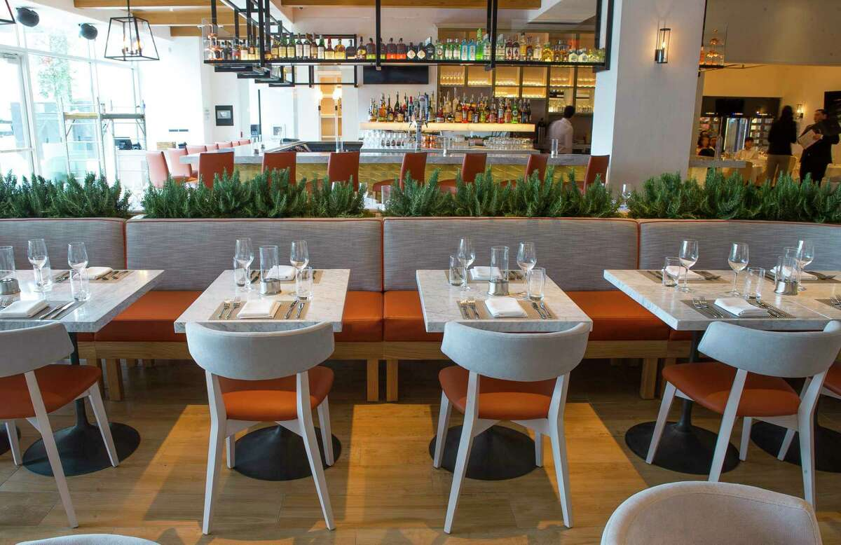 Seating and the bar at the Fig & Olive, a new restaurant in the Galleria.