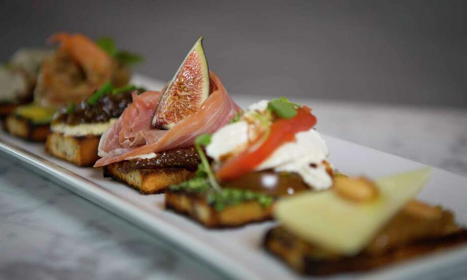 Six of the signature crostini including (L to R) the Mushroom, Burrata, Goat Cheese, Manchego, Shrimp and Prosciutto at the Fig & Olive, a new restaurant in the Galleria opening March 9. Photo: Mark Mulligan, Houston Chronicle / © 2018 Houston Chronicle