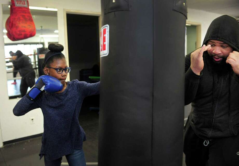 Young boxer ten-year-old Nezaeh Clark practices with instrcutor Jerrid Ballard Saturday, March 3, 2018, at The Police Activities League (PAL)s new boxing gym at 11 Allen Rd. in Norwalk, Conn. The gym located adjacent to the Norwalk Senior Center will be the home to a youth boxing club that started in 1980. Photo: Erik Trautmann / Hearst Connecticut Media / Norwalk Hour