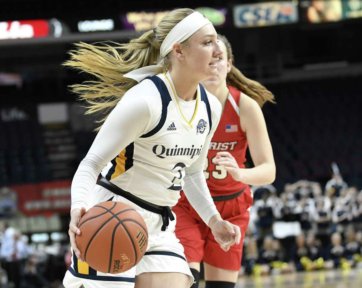 Quinnipiac's Taylor Herd drives around Marist guard Rebekah Hand during Monday's MAAC championship game in Albany, N.Y.