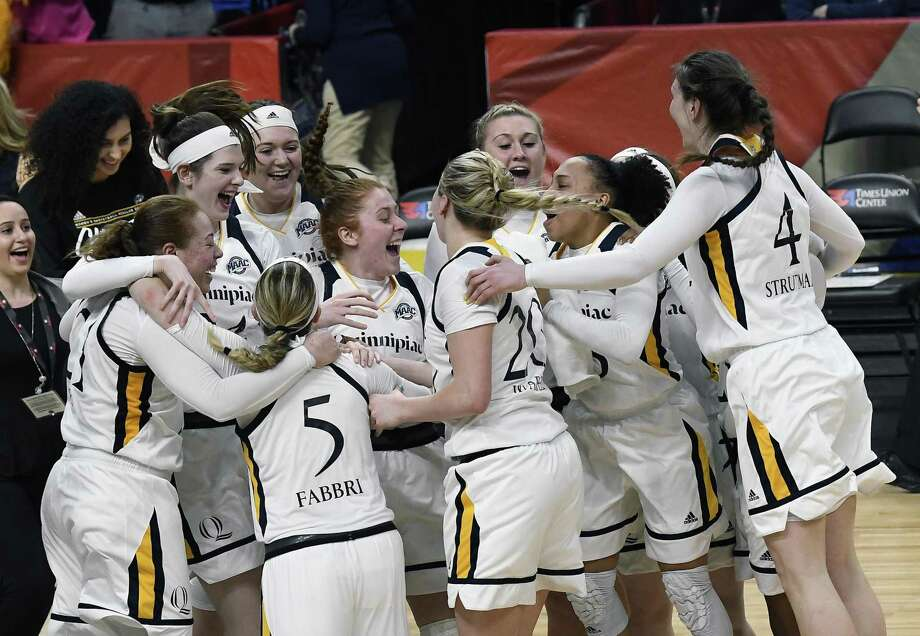 Quinnipiac players celebrate their win over Marist in the MAAC championship game on Monday in Albany, N.Y. Photo: Hans Pennink / Associated Press / FR58980 AP