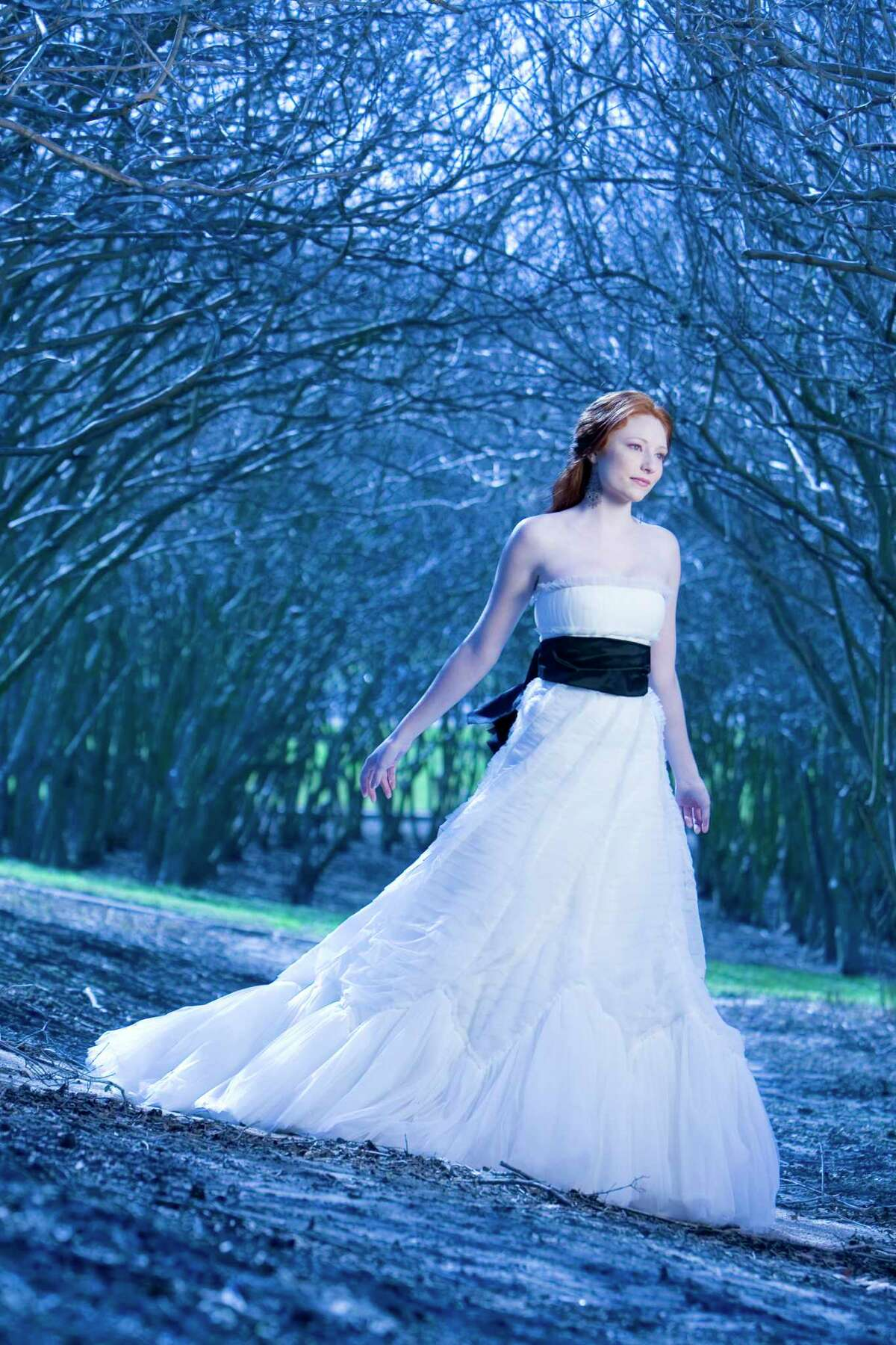 Chelsea McMahon models for a past Chronicle fashion shoot at the blue trees at the Waugh-Memorial cloverleaf.