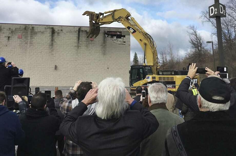 People make pictures, Monday, March 5, 2018, during a ceremony in East Windsor, Conn., marking the start of demolition of a movie theater at the site of what they hope will be a new casino that the Mashantucket Pequot and the Mohegan tribes would operate jointly. Photo: Susan Haigh / Associated Press / Copyright 2018 The Associated Press. All rights reserved.