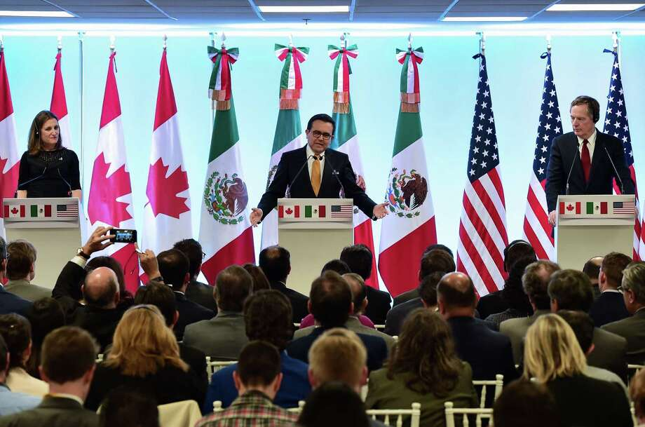 """Canadian Minister of Foreign Affairs, Chrystia Freeland (L), Mexican Economy Minister Idelfonso Guajardo (C) and US Trade Representative Robert Lighthizer give a message to the media during the seventh round of NAFTA (North American Free Trade Agreement) talks in Mexico City, on March 5, 2018. US President Donald Trump said he would not back down on the tariffs, nor offer exclusions to NAFTA partners Canada and Mexico unless he gets a """"fair"""" deal in the current negotiations to revamp the 1994 trade agreement. Photo: RONALDO SCHEMIDT /AFP /Getty Images / AFP or licensors"""