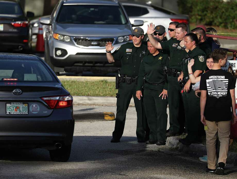 Broward County officers welcome students back to Marjory Stoneman Douglas High School on Thursday. A reader sees differing priorities in the aftermath of the mass shooting there. Photo: Joe Raedle /Getty Images / 2018 Getty Images