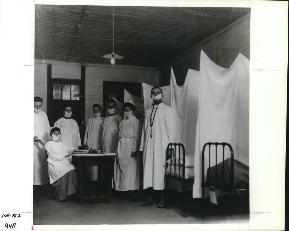 This influenza ward shows the isolation method of treating Spanish flu patients in France near the end of World War I. Such methods were unsuccessful in containing the virulent, airborne influenza virus. Photo: / / Houston Chronicle