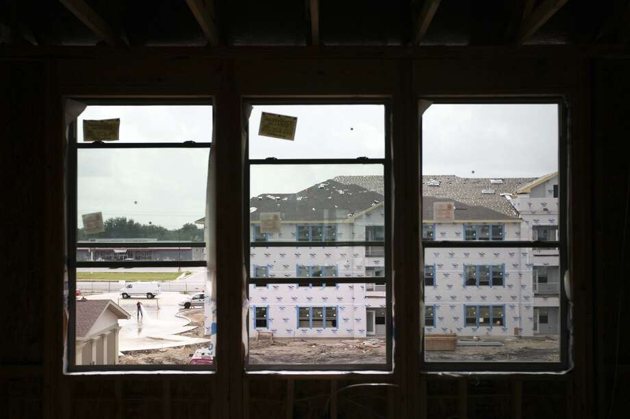 The view from the living room of an apartment at Montabella Pointe Apartments, a new affordable housing complex that will provide affordable rents to military veterans, is pictured under construction in 2011. Such projects can stir objections in neighborhoods. No one should be quick to label this as NIMBYism. Photo: ANDREW BUCKLEY /SAN ANTONIO EXPRESS-NEWS / abuckley@express-news.net