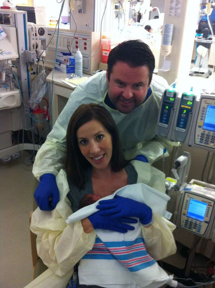Tory Guerra, with husband Rafael, shortly after the births of their twins. Photo: Courtesy /