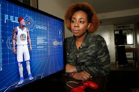 Sabrina Patton with the player she created, Giovanni Patton that she controls in the playstation game video game NBA 2K18, seen in Hayward, Calif., on Fri. Mar.2, 2018. She and her boyfriend Toussaint Taylor have hopes of being drafted by the Golden State Warriors to play a new e-sports league, the inaugural NBA 2K league.
