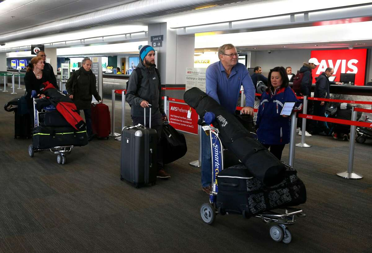 Airline travelers arrive at the rental car center at San Francisco International Airport in San Francisco, Calif. on Saturday, March 3, 2018.