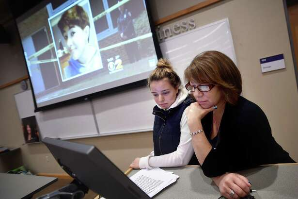 Alia Mostafa (left), president of the Collegiate Health Service Corp at the University of Bridgeport and a childhood friend of Maren Sanchez, and Maren's mother, Donna Cimarelli, watch a video segment reporting on Maren's death during a talk at the University of Bridgeport on February 23.