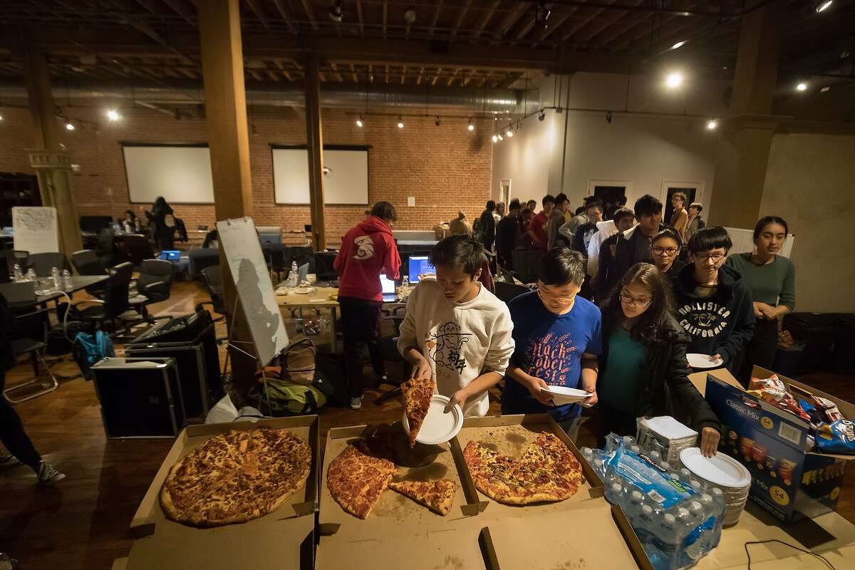 High School hackers line up for pizza at San Francisco'?s first hackathon for high schoolers on Saturday, March 3, 2018 in San Francisco, Calif.