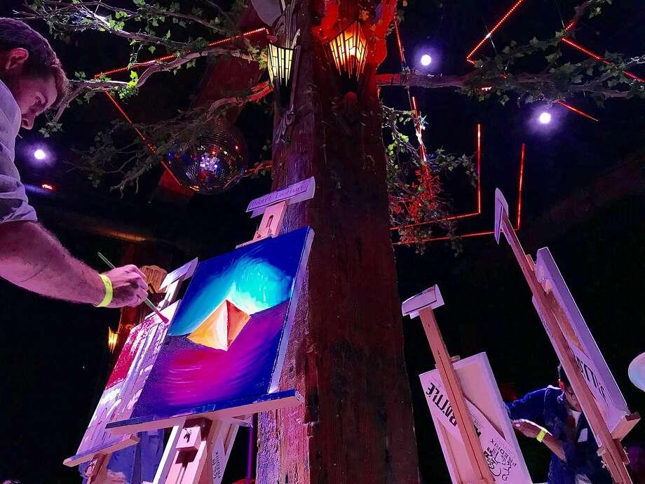 Contestants take part in Art Battle atthe Great Northern nightclub in San Francisco. Photo: Beth Spotswood