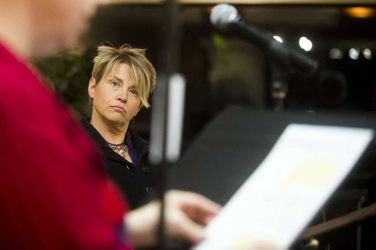 Trena Winans of Auburn listens as Cara Baker of Midland reads her lines during a rehearsal for Creative 360's next radio drama, the 1957-style sci-fi drama ?'BLAST OFF?