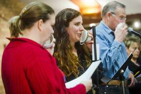 From left, Cara Baker of Midland, Joannah Lodico of Midland, John McPeak of Midland and Trena Winans of Auburn read their lines during a rehearsal for Creative 360's next radio drama, the 1957-style sci-fi drama ÒBLAST OFFÓ by Tony Palermo, on Thursday, March 1, 2018 at Creative 360. The drama will be performed on Saturday, March 10 at 7:00 p.m. Admission is $10 pre-paid, $12 at the door. (Katy Kildee/kkildee@mdn.net)