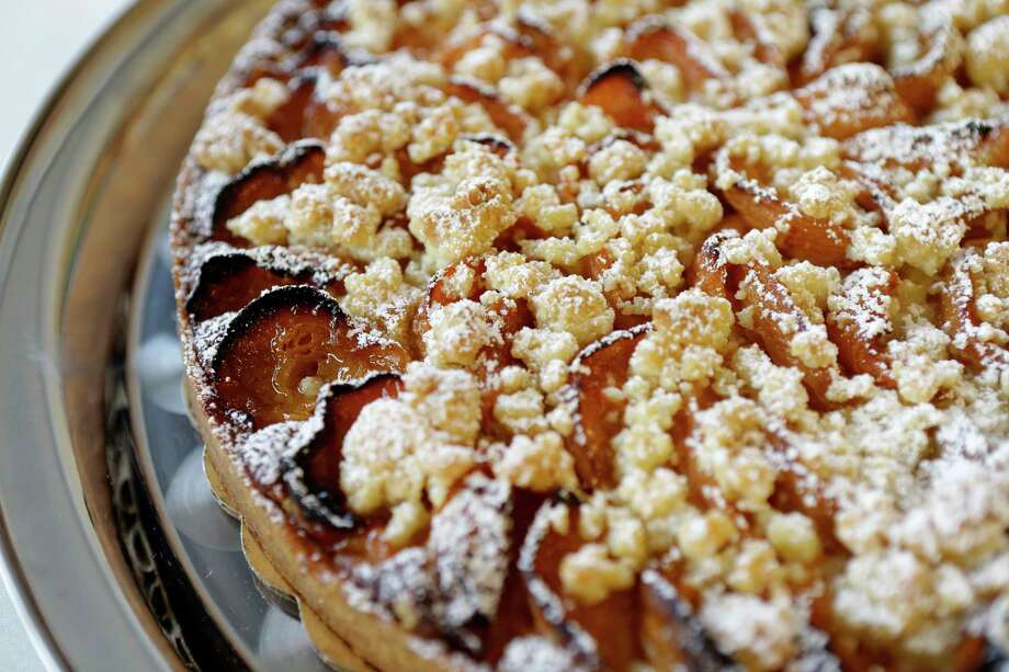 A whole apricot tart is shown at Eclair Paris, 2278 W. Holcombe Blvd., Thursday, March 1, 2018, in Houston. ( Melissa Phillip / Houston Chronicle ) Photo: Melissa Phillip, Staff / © 2018 Houston Chronicle