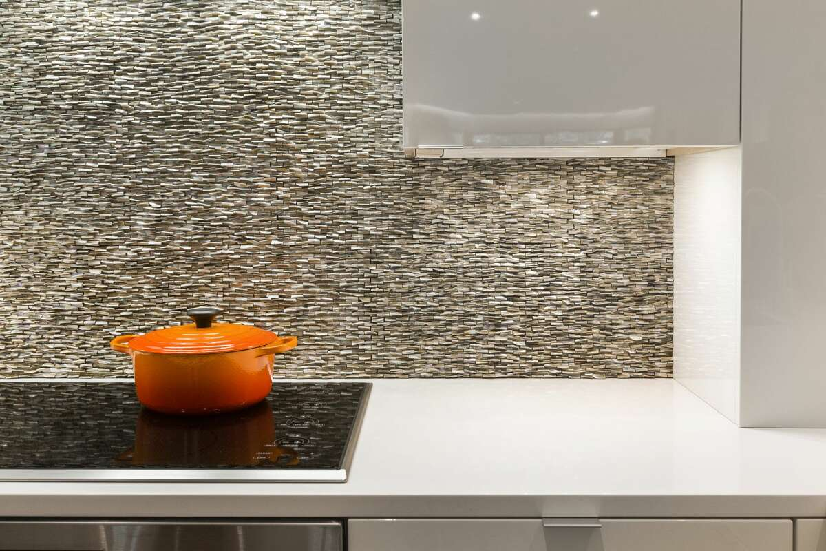 This stacked stone backsplash is an artful touch in the kitchen.
