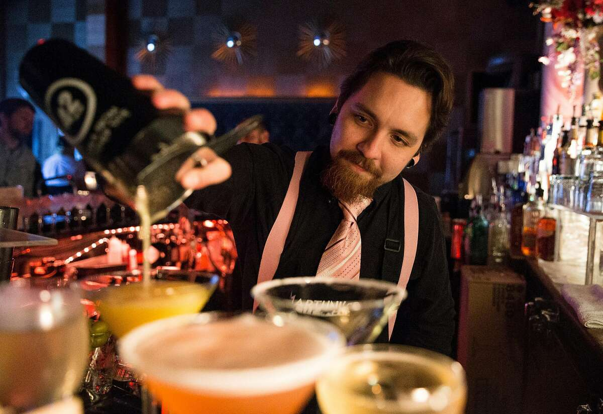Bartender Vlad Korishev pours a Creamsicle at Martuni's Friday, March 2, 2018 in San Francisco, Calif.