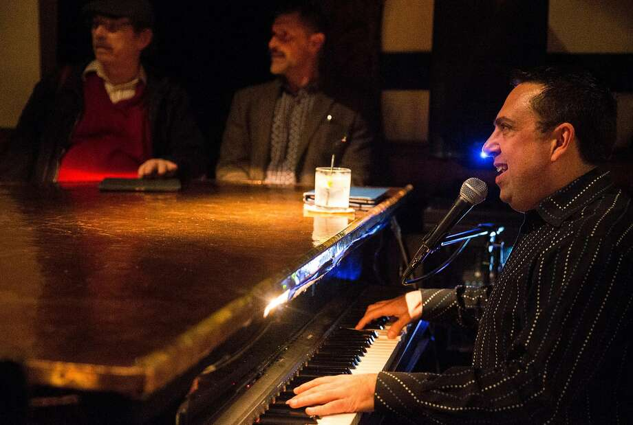 Pianist Ben Prince sings while playing the piano at Martuni's in S.F. Photo: Jessica Christian, The Chronicle