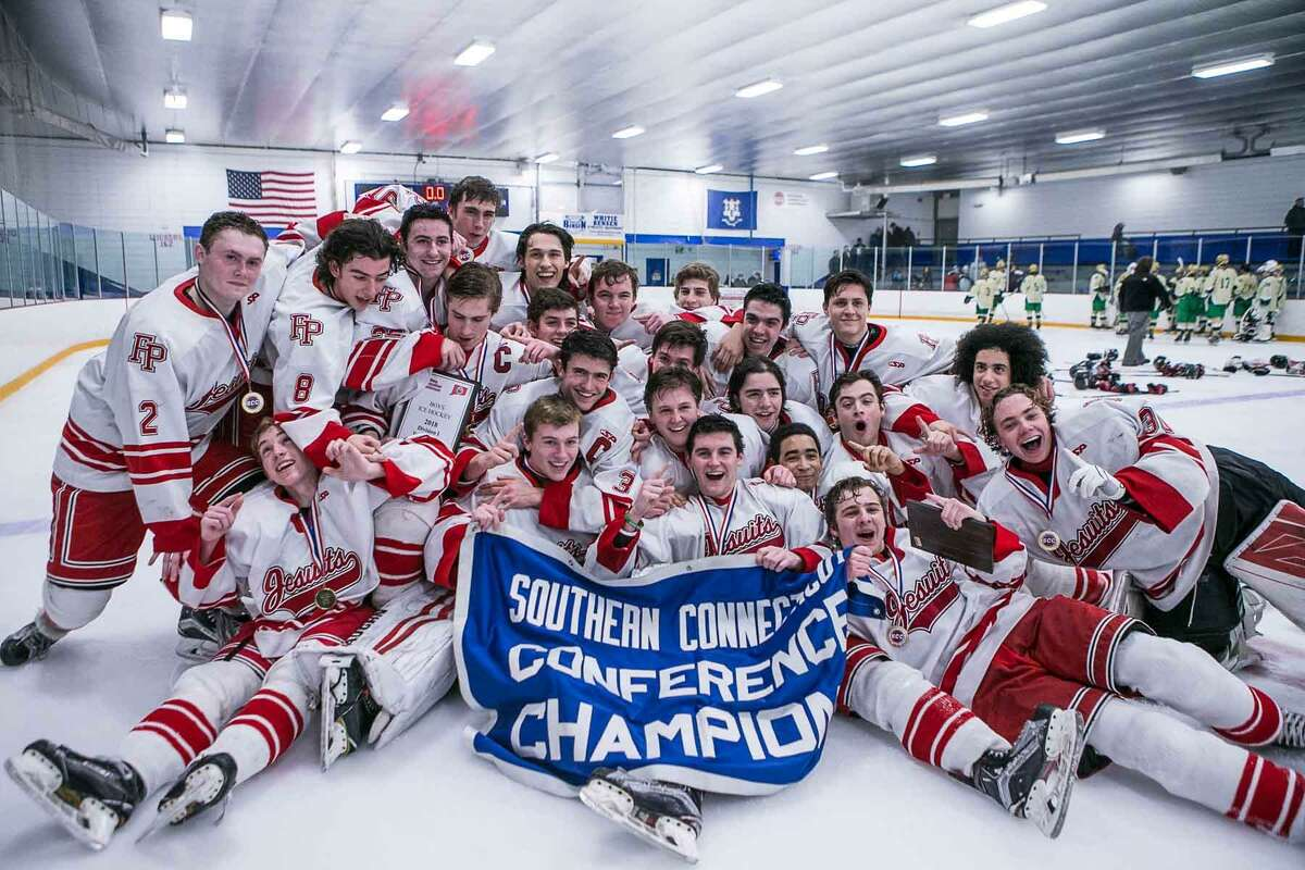 The Fairfield Prep boys hockey team celebrated their SCC-SWC championship on Saturday. The Jesuits enter the CIAC Division I tournament 14-0 against Connecticut competition.