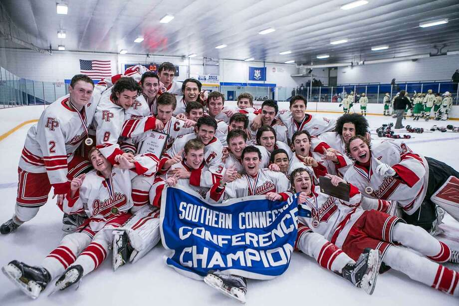 The Fairfield Prep boys hockey team celebrated their SCC-SWC championship on Saturday. The Jesuits enter the CIAC Division I tournament 14-0 against Connecticut competition. Photo: John Vanacore / For Hearst Connecticut Media / (C)John H.Vanacore