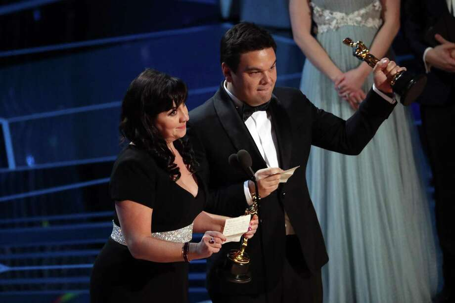 """Kristen Anderson-Lopez and Robert Lopez accept the award for best song for """"Remember Me"""" from """"Coco"""" at the 90th Academy Awards in Los Angeles on Sunday, March 4, 2018. Photo: PATRICK T. FALLON /NYT / NYTNS"""