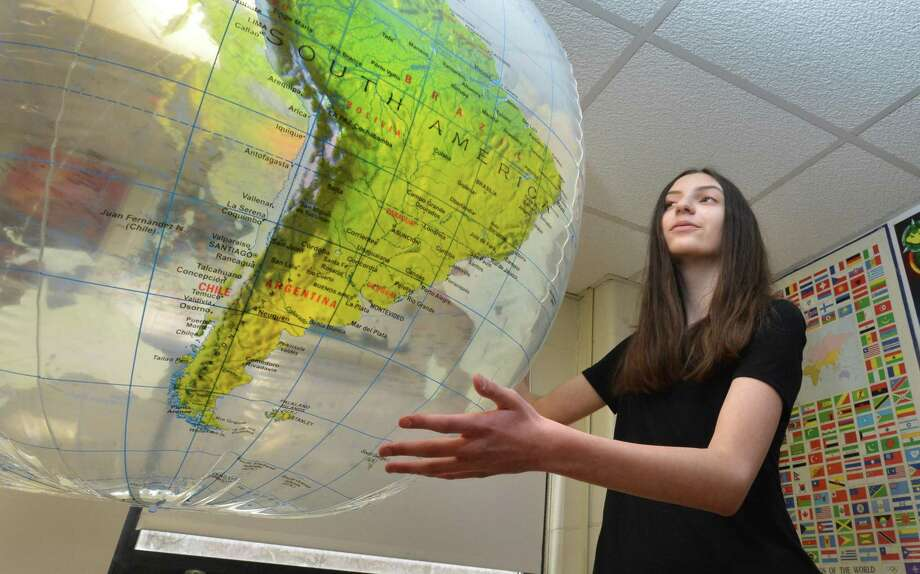 Roton Middle School eighth-grader Claire DiChiaro spins a large globe in the science lab at the school on Monday March 5, 2018 in Norwalk Conn. She has qualified for the 2018 National Goeographic State Bee for the second year in a row. She will compete on April 6 at Central Connecticut State University for a chance the compete at the national level. Photo: Alex Von Kleydorff / Hearst Connecticut Media / Norwalk Hour