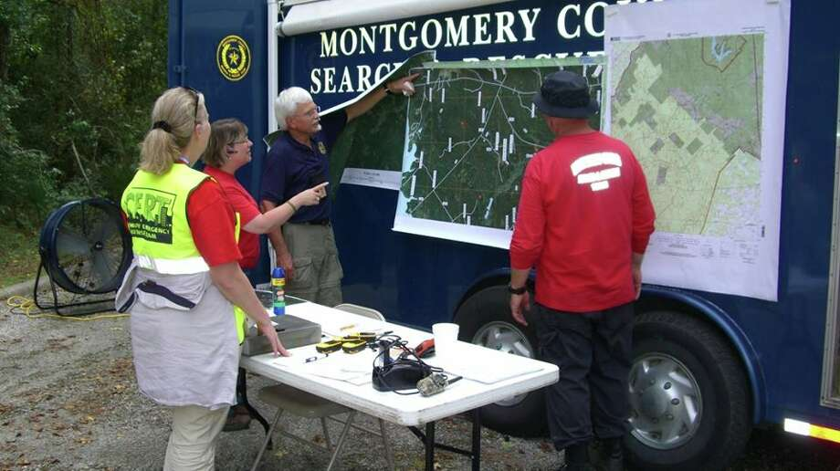 The Montgomery County Search & Rescue look over maps of a region during a past search. Photo: MOCSAR