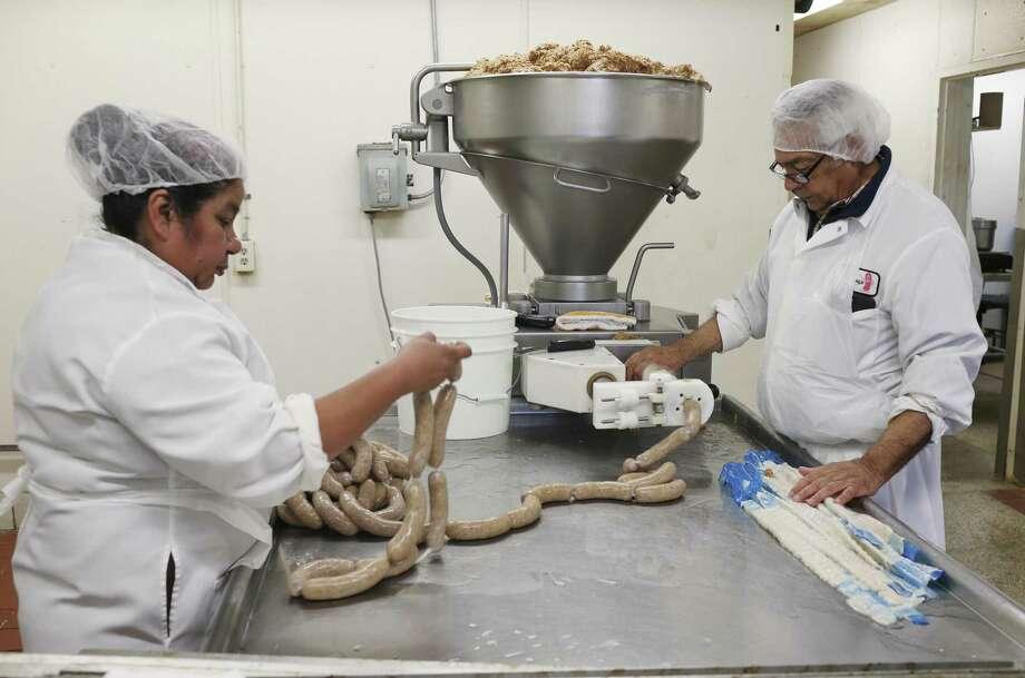 Alex Peña makes Polish sausage with Rosio Covarrubias at Mertz Sausage, a business that has been open since 1929. Photo: Jerry Lara /San Antonio Express-News / © 2018 San Antonio Express-News