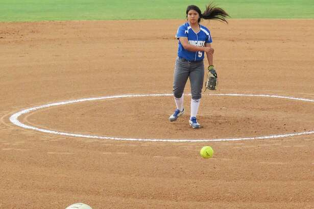 Emma Steed takes a pitch for the Alexander Lady Bulldogs from South San Antonio starting pitcher Caitlyn Rangel, Wednesday, April 12, 2017 at the UISD SAC.