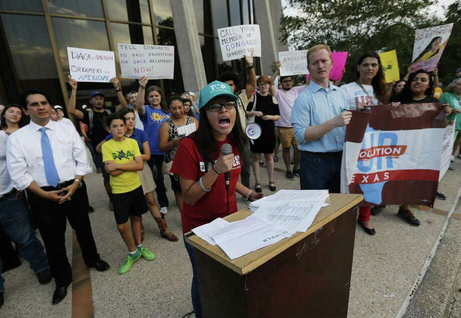 Jessica Azua of Texas Organizing Project and a DACA recipient speaks at a rally in response to President Trump's decision on DACA at the Federal courthouse that garners nearly 200 people opposed to his decision on Tuesday, Sept. 5, 2017. (Kin Man Hui/San Antonio Express-News) Photo: Kin Man Hui, Staff / San Antonio Express-News / ©2017 San Antonio Express-News